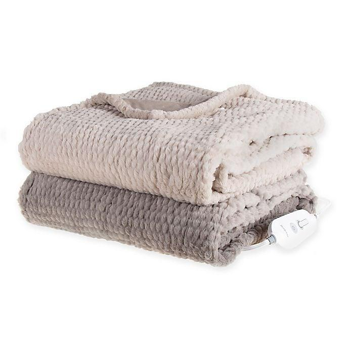<p>She'll stay warm and cozy with the <span>Brookstone N-a-p Heated Faux Fur Throw </span> ($70).</p>