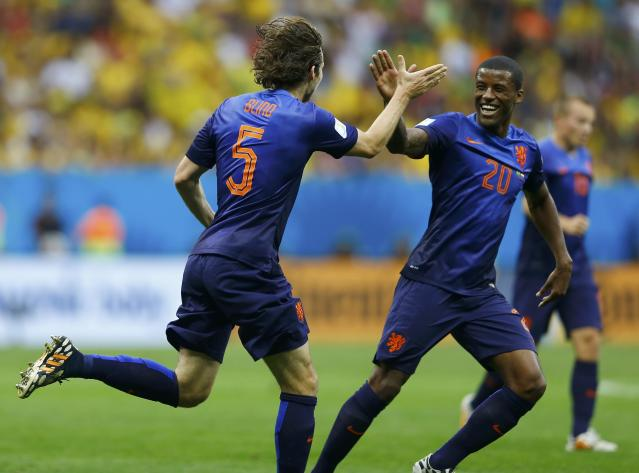 Daley Blind (L) of the Netherlands celebrates scoring their second goal with Georginio Wijnaldum during their 2014 World Cup third-place playoff against Brazil at the Brasilia national stadium in Brasilia July 12, 2014. REUTERS/Dominic Ebenbichler (BRAZIL - Tags: SOCCER SPORT WORLD CUP)