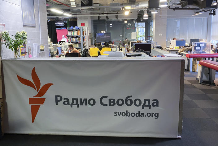 Journalists work at a newsroom of Radio Free Europe/Radio Liberty's Moscow Bureau in Moscow, Russia, Wednesday, Jan. 27, 2021. Russian court bailiffs have shown up at U.S.-funded Radio Free Europe/Radio Liberty's Moscow Bureau to notify it about the launch of enforcement proceedings over unpaid fines. RFE/RL denounced the move as a serious escalation in the Russian government's campaign to drive it out of the country. (Anton Sergienko, RFE/RL via AP)