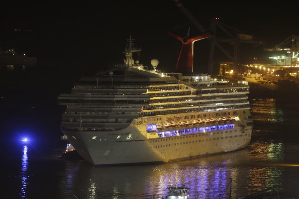 The cruise ship Carnival Triumph is towed up the Mobile River in Mobile, Ala., Thursday, Feb. 14, 2013. The ship with more than 4,200 passengers and crew members has been idled for nearly a week in the Gulf of Mexico following an engine room fire. (AP Photo/Dave Martin)