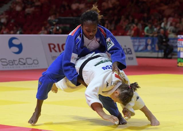 France's Clarisse Agbegnenou (top) competes against Slovenia's Tina Trstenjak during their final match in the women's -63kg category at the World Judo Championships in Budapest on August 31, 2017 (AFP Photo/ATTILA KISBENEDEK)