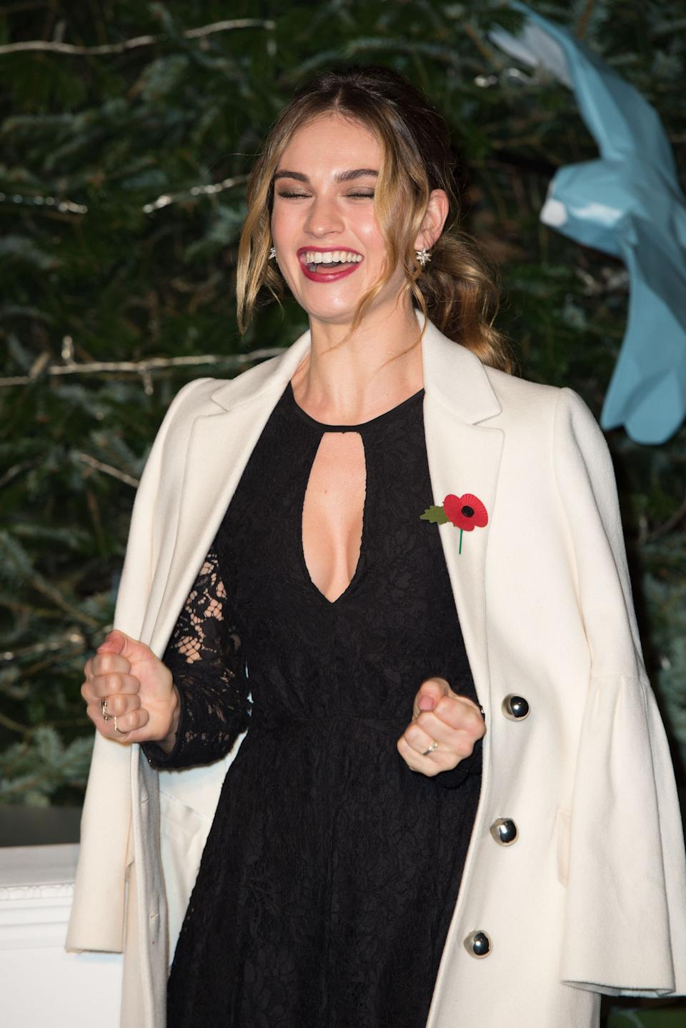 Lily James turns on the Christmas tree lights at Harrods in London.