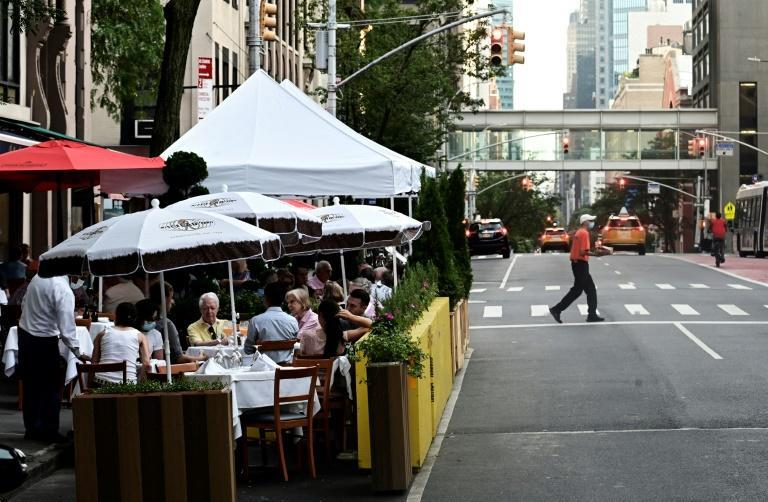 People dining outside a restaurant in Manhattan as New York tries to get back its famous energy after the COVID crisis