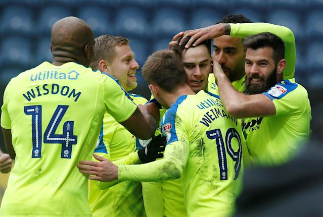 """Soccer Football - Championship - Preston North End vs Derby County - Deepdale, Preston, Britain - April 2, 2018 Derby County's Tom Lawrence celebrates with teammates after he scores his sides first goal Action Images/Craig Brough EDITORIAL USE ONLY. No use with unauthorized audio, video, data, fixture lists, club/league logos or """"live"""" services. Online in-match use limited to 75 images, no video emulation. No use in betting, games or single club/league/player publications. Please contact your account representative for further details."""