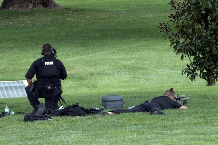"""<div class=""""inline-image__caption""""><p>A police sniper team seen near the Library of Congress as the situation unfolded.</p></div> <div class=""""inline-image__credit"""">Win McNamee/Getty</div>"""