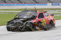 Matt Kenseth drives his damaged car during the NASCAR Cup Series auto race at Texas Motor Speedway in Fort Worth, Texas, Wednesday, Oct. 28, 2020. (AP Photo/Richard W. Rodriguez)