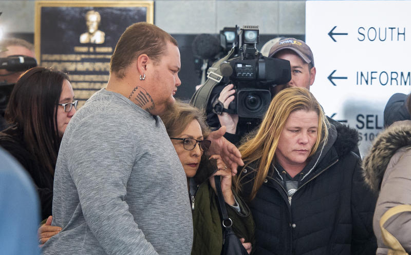 FILE - In this Feb. 21, 2019, file photo, several members of James Alan Neal's family leave El Paso County's Terry R. Harris Judicial Complex in Colorado Springs, Colo. Neal, 72, was arrested Tuesday, Feb. 19, 2019, in Colorado Springs, Colo., and charged with murder with special circumstances in the death of Linda O'Keefe, who was found strangled in 1973, a case that has long shaken the seaside community of Newport Beach, Calif., Orange County District Attorney Todd Spitzer said. James Neal of Monument, Colo. also pleaded not guilty in an Orange County courtroom Friday, March 29, 2019, to lewd and lascivious acts on two girls under the age of 14. Those alleged crimes happened between 1995 and 2004 in Riverside County east of Los Angeles. (Dougal Brownlie/The Gazette via AP, File)