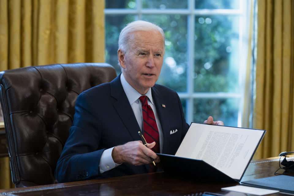 President Joe Biden signs a series of executive orders on health care, in the Oval Office of the White House on Jan. 28, 2021, in Washington. (Evan Vucci/AP)