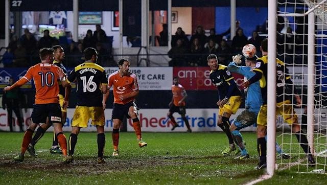 <p>You could easily walk past Luton's home and not even realise the stadium was hidden amongst a load of houses. </p> <br><p>Supporters can even see the gardens of residents whilst walking through the gates, with Kenilworth Road having a remarkable older feel of English football to it.</p> <br><p>The ground holds just over 10,000 people and it remains a stadium that feels more in touch with the 19th century than the 21st. </p>