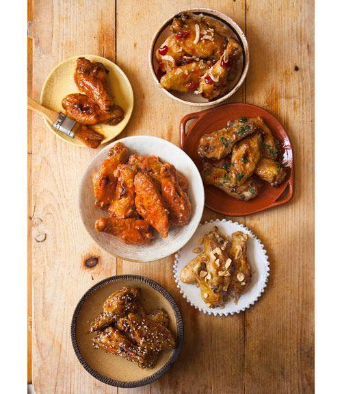"""<p>Why settle for one style of chicken wings when you can have five? </p><p>Get the recipe for: <br><em>• <a href=""""https://www.goodhousekeeping.com/food-recipes/a15018/bourbon-bbq-wings-recipe-ghk0113/"""" rel=""""nofollow noopener"""" target=""""_blank"""" data-ylk=""""slk:Bourbon BBQ Wings »"""" class=""""link rapid-noclick-resp"""">Bourbon BBQ Wings »</a><br>• <a href=""""https://www.goodhousekeeping.com/food-recipes/a11454/fiery-buffalo-wings-recipe-ghk0113/"""" rel=""""nofollow noopener"""" target=""""_blank"""" data-ylk=""""slk:Fiery Buffalo Wings »"""" class=""""link rapid-noclick-resp"""">Fiery Buffalo Wings »</a><br>• <a href=""""https://www.goodhousekeeping.com/food-recipes/a14219/sweet-n-sticky-thai-wings-recipe-ghk0113/"""" rel=""""nofollow noopener"""" target=""""_blank"""" data-ylk=""""slk:Sweet 'n' Sticky Thai Wings »"""" class=""""link rapid-noclick-resp"""">Sweet 'n' Sticky Thai Wings »</a><span class=""""redactor-invisible-space""""><a href=""""https://www.goodhousekeeping.com/food-recipes/a14219/sweet-n-sticky-thai-wings-recipe-ghk0113/"""" rel=""""nofollow noopener"""" target=""""_blank"""" data-ylk=""""slk:"""" class=""""link rapid-noclick-resp""""><br></a></span><em>• </em><a href=""""https://www.goodhousekeeping.com/food-recipes/a14982/ballpark-wings-recipe-ghk0113/"""" rel=""""nofollow noopener"""" target=""""_blank"""" data-ylk=""""slk:Ballpark Wings »"""" class=""""link rapid-noclick-resp"""">Ballpark Wings »</a><span class=""""redactor-invisible-space""""><br></span>• </em><a href=""""https://www.goodhousekeeping.com/food-recipes/a14988/sesame-teriyaki-wings-recipe-ghk0113/"""" rel=""""nofollow noopener"""" target=""""_blank"""" data-ylk=""""slk:Sesame Teriyaki Wings »"""" class=""""link rapid-noclick-resp""""><em>Sesame Teriyaki Wings »</em></a></p>"""