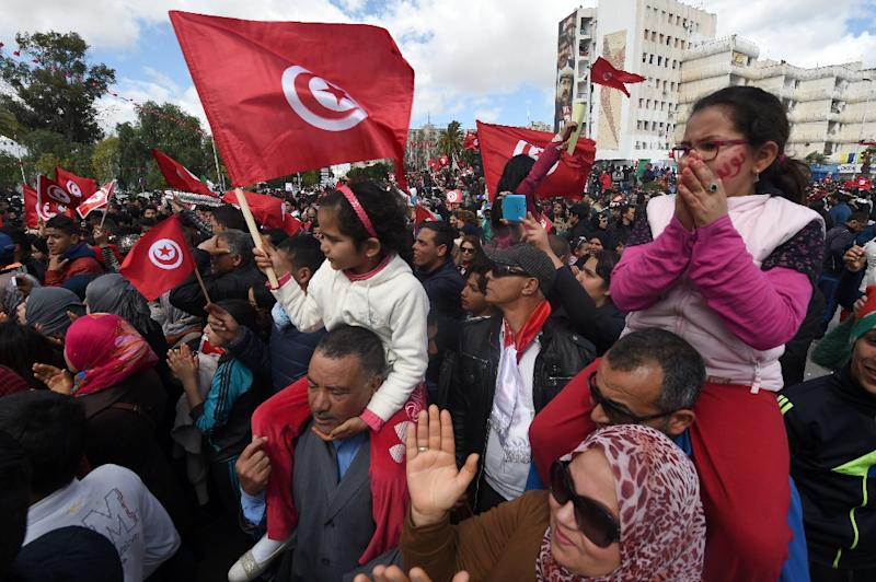 "Chanting ""Tunisia is free! Terrorism out!"" the demonstrators marched in a sea of red Tunisian flags to the capital's Bardo Museum (AFP Photo/Fethi Belaid)"