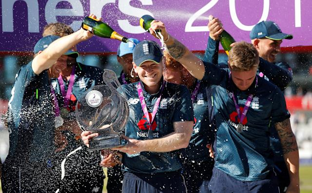 Cricket - England v Australia - Fifth One Day International - Emirates Old Trafford, Manchester, Britain - June 24, 2018 England's Eoin Morgan celebrates with the trophy and team mates after winning the series Action Images via Reuters/Craig Brough