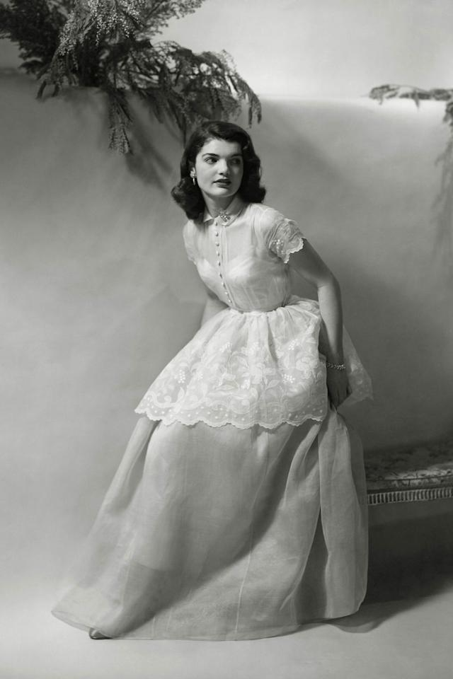 <p>Before she became the wife of a rising politician, Jacqueline Bouvier had polished debutante style down. An elegant long white dress is just the ticket.</p>