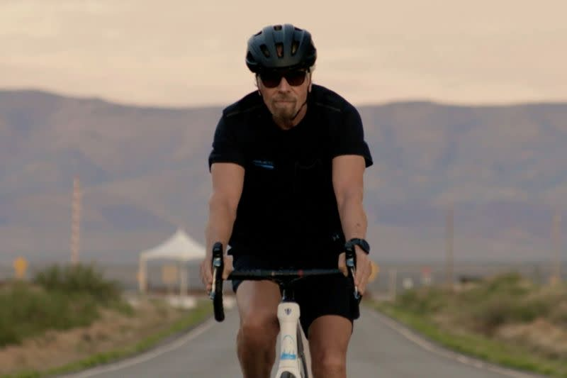 FILE PHOTO: Richard Branson arrives by bicycle to Spaceport America