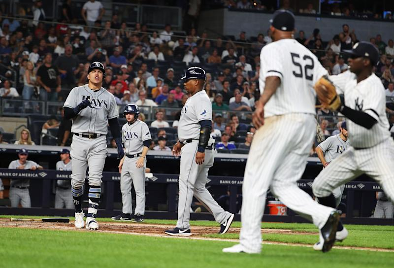NEW YORK, NEW YORK - JULY 16: Avisail Garcia #24 of the Tampa Bay Rays has words with CC Sabathia #52 of the New York Yankees after an at bat in the sixth inning during their at Yankee Stadium on July 16, 2019 in New York City. (Photo by Al Bello/Getty Images)