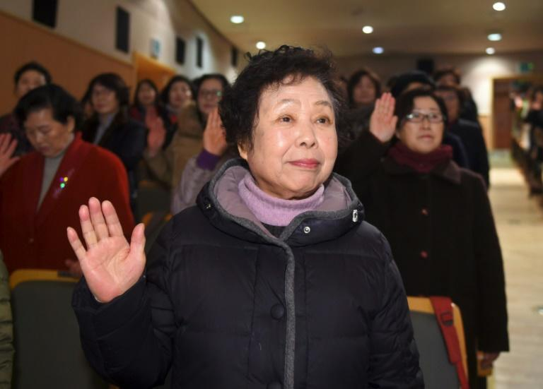 Kim Soon-Sil, 88, (C) had to leave school age 13 and has returned now to study history and English