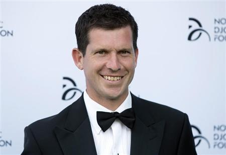 Former tennis player Tim Henman poses for photographers as he arrives at a fundraising dinner for the Novak Djokovic Foundation in London July 8, 2013. REUTERS/Neil Hall