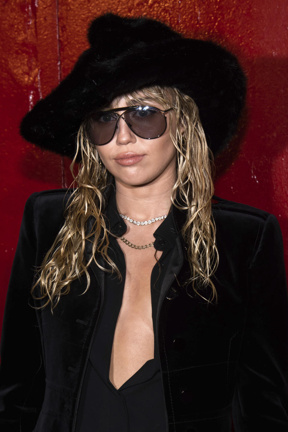 Miley Cyrus arrives to the Tom Ford show during Fashion Week on Monday, Sept. 9, 2019 in New York. (Photo by Charles Sykes/Invision/AP)