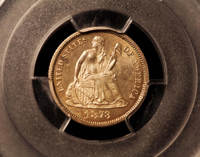 An 1873 dime from Carson City, Nev., is displayed on Friday, Aug. 10, 2012, in Philadelphia. The dime sold at auction for $1.84 million. (AP Photo/Brynn Anderson)
