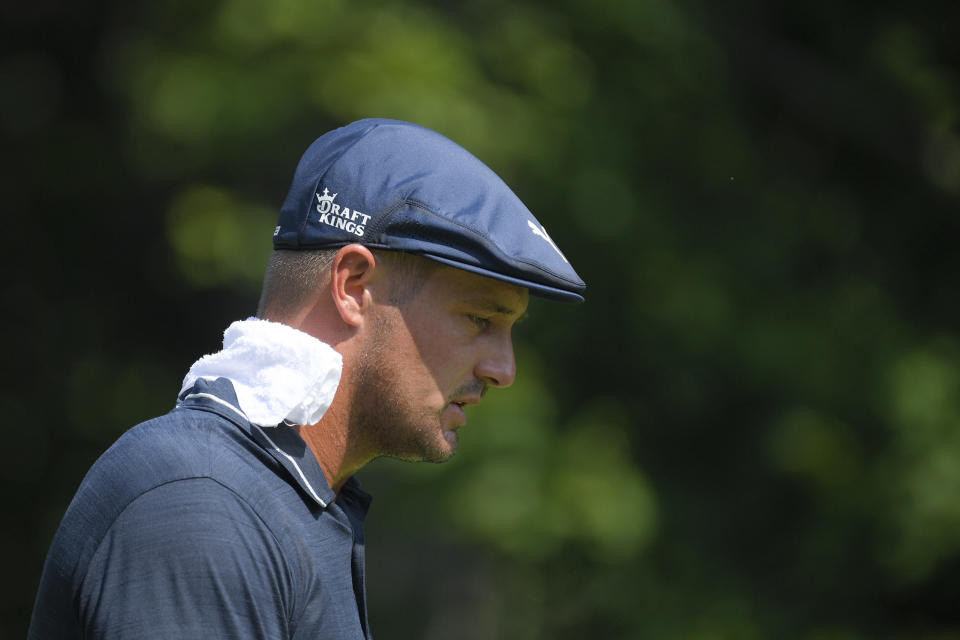 Bryson DeChambeau wears a towel on his neck during high temperatures after teeing off on the second hole during the second round of the BMW Championship golf tournament, Friday, Aug. 27, 2021, at Caves Valley Golf Club in Owings Mills, Md. (AP Photo/Nick Wass)