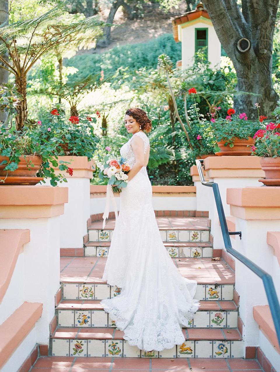 """<p>Ana knew her <a href=""""https://eddyk.com/"""" rel=""""nofollow noopener"""" target=""""_blank"""" data-ylk=""""slk:Eddy K. Europe"""" class=""""link rapid-noclick-resp"""">Eddy K. Europe</a> wedding dress was the one when stepped into it at a bridal atelier and realized she never wanted to take it off. The sleeveless fit-and-flare gown was complete with an illusion neckline, keyhole back, and lace appliqués.</p>"""