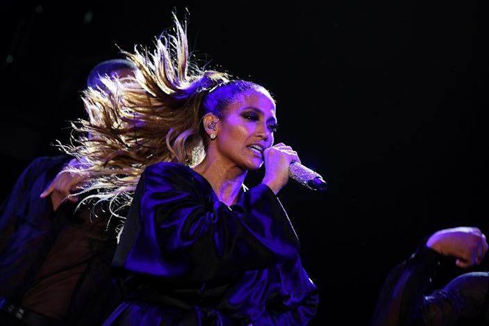 """US singer Jennifer Lopez performs during """"Go Out to Vote"""" concert for Democratic presidential nominee Hillary Clinton in Miami, Florida (AFP Photo/Jewel Samad)"""
