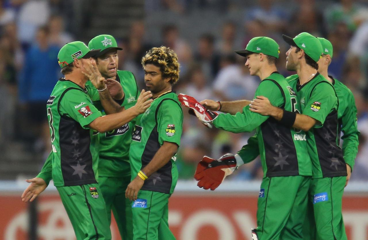 MELBOURNE, AUSTRALIA - DECEMBER 21:  Lasith Malinga of the Stars is congratulated by his team mates after he dismissed Brad Haddin of the Sixers during the Big Bash League match between the Melbourne Stars and the Sydney Sixers at Melbourne Cricket Ground on December 21, 2012 in Melbourne, Australia.  (Photo by Scott Barbour/Getty Images)
