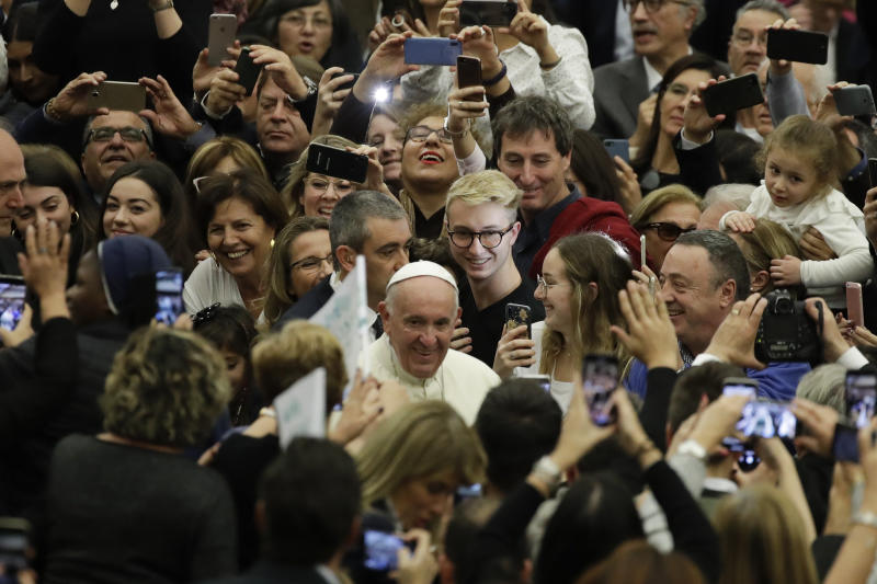Pope Francis arrives in the Paul VI Hall at the Vatican for an audience with students and teachers of the LUMSA Catholic University, Thursday, Nov. 14, 2019. (AP Photo/Alessandra Tarantino)