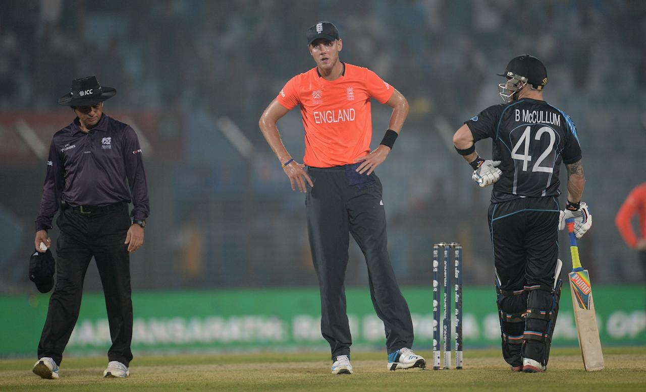 CHITTAGONG, BANGLADESH - MARCH 22:  England captain Stuart Broad speaks with umpire Aleem Dar and Brendon McCullum of New Zealand before the game is stopped for rain during the ICC World Twenty20 Bangladesh 2014 group 1 match between England and New Zealand at Zahur Ahmed Chowdhury Stadium on March 22, 2014 in Chittagong, Bangladesh.  (Photo by Gareth Copley/Getty Images)