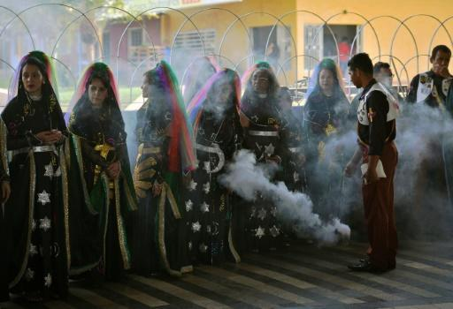 "A group of Vale do Amanecer ""nymphs"" receive a blessing with incense"