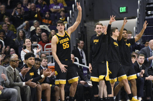 Iowa center Luka Garza (55) gestures after a 3-point basket against Northwestern during the second half of an NCAA college basketball game Tuesday, Jan. 14, 2020, in Evanston, Ill. (AP Photo/David Banks)