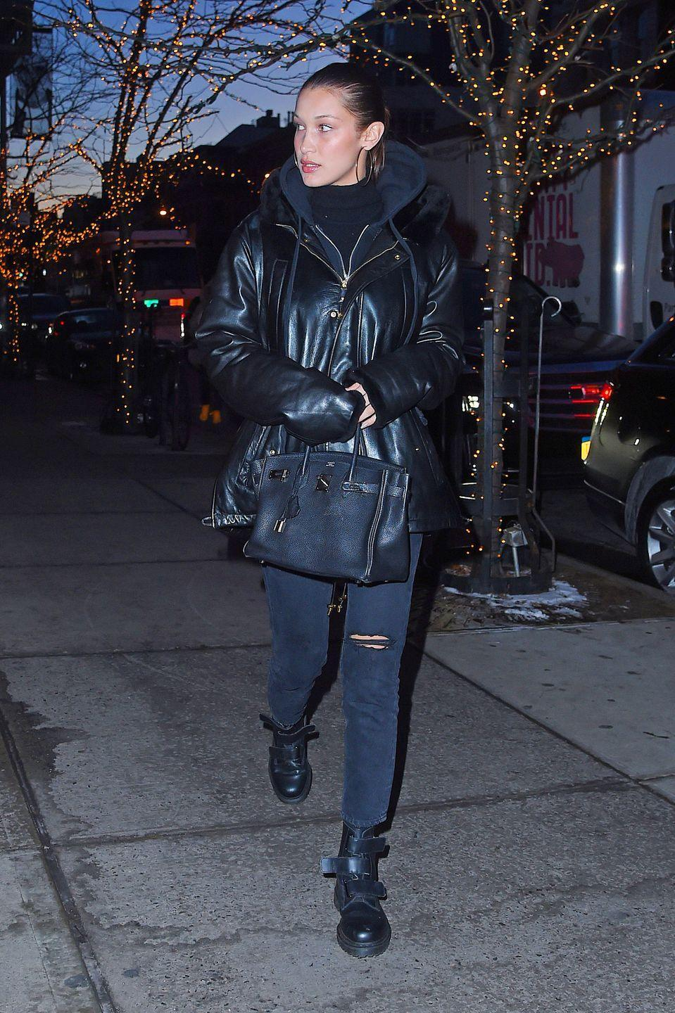 <p>In a black puffy coat, black boots, and jeans while out in New York City. </p>