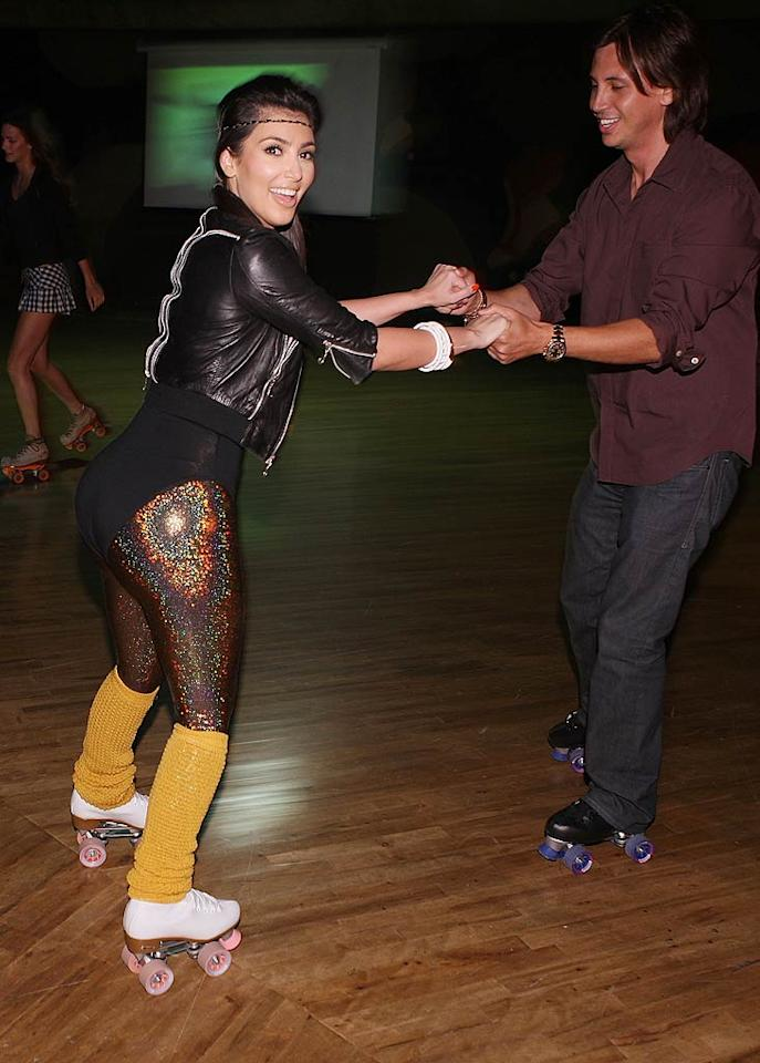 Kim went retro and racy in a figure-hugging leotard, sparkly tights, and legwarmers for a roller rink party with pal Jonathan Cheban in L.A. in April 2009. So that's what Kim would've looked like in the early '80s...   (April 29, 2009)