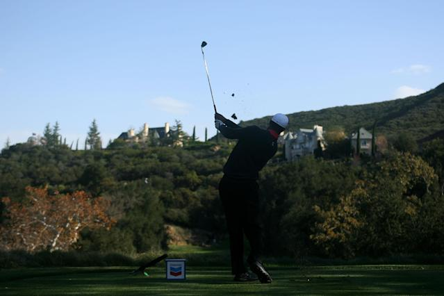 THOUSAND OAKS, CA - DECEMBER 01: Tiger Woods hits his tee shot on the 17th hole during the first round of the Chevron World Challenge at Sherwood Country Club on December 1, 2011 in Thousand Oaks, California. (Photo by Robert Meggers/Getty Images)