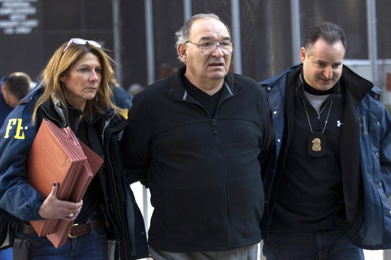 "Thomas 'Tommy D' Di Fiore is escorted by FBI agents from their Manhattan offices in New York January 23, 2014. Five reported members of a New York crime family were taken into custody on Thursday and charged with crimes including racketeering, murder and the long-unsolved 1978 Lufthansa heist at John F. Kennedy International Airport. Court papers unsealed in New York charge that the men were members of the Bonanno crime family, which also committed acts of extortion and arson, including the airport heist, a brazen crime made famous by the 1990 film ""Goodfellas."" REUTERS/Brendan McDermid (UNITED STATES - Tags: CRIME LAW)"