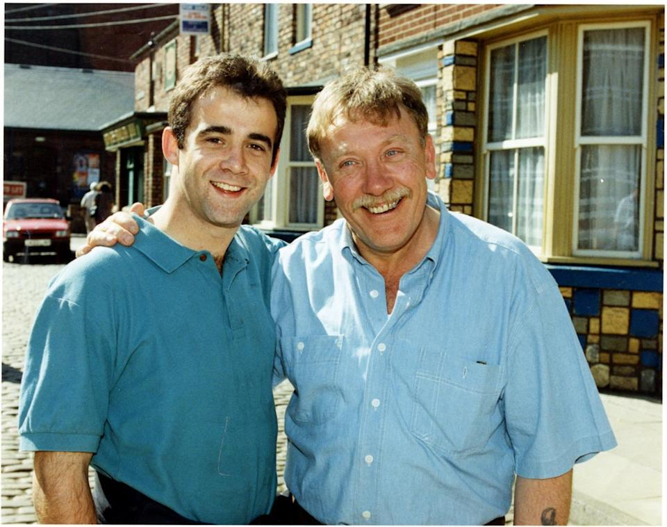 Happy family: Armitage with his onscreen son Kevin Webster played by Michael Le Vell