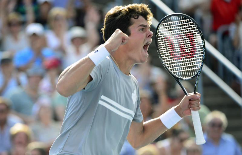Milos Raonic reacts after defeating fellow Canadian Vasek Pospisil during Rogers Cup men's tennis semifinals in Montreal, Saturday, Aug. 10, 2013. (AP Photo/The Canadian Press, Paul Chiasson)