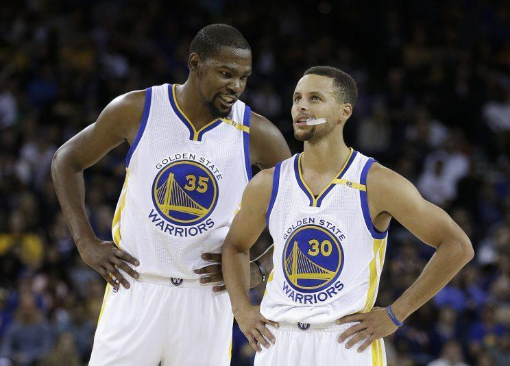 The new CBA affects the Warriors' plans to retain Kevin Durant and Steph Curry. (AP)