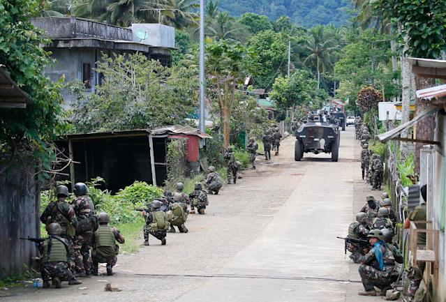 <p>Government troops head to the frontline as fighting with Muslim militants in Marawi city enters its second week Tuesday, May 30, 2017, in the southern Philippines. Philippine forces pressed their offensive to drive out militants linked to the Islamic State group after days of fighting left corpses in the streets and hundreds of civilians begging for rescue from a besieged southern city of Marawi. (Bullit Marquez/AP) </p>