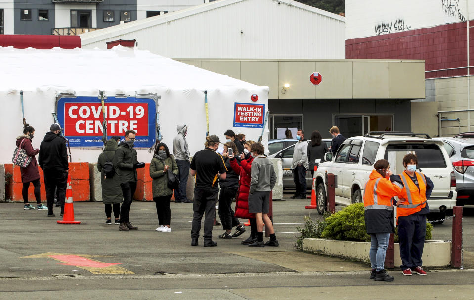 People queue outside a COVID-19 testing station in central Wellington, New Zealand, Wednesday, June, 23, 2021. After enjoying nearly four months without any community transmission of the coronavirus, New Zealanders were on edge Wednesday after health authorities said an infectious traveler from Australia had visited over the weekend. (Jack Crossland/NZ Herald via AP)