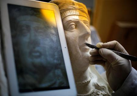 A specialist works on a damaged statue from Palmyra at Syria's National Museum of Damascus, Syria January 9, 2019. Picture taken January 9, 2019. REUTERS/Omar Sanadiki