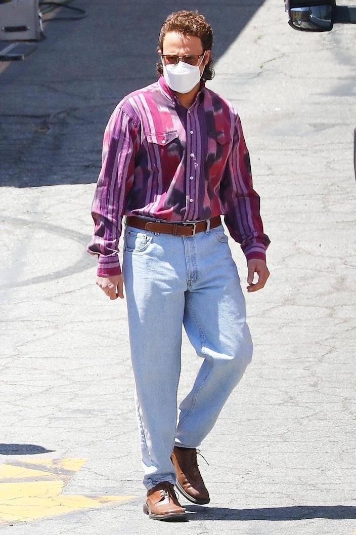 <p>Seth Rogan goes totally '80s on the set of <em>Pam & Tommy </em>in L.A. on Tuesday. </p>