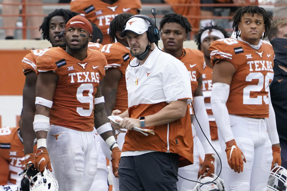 Texas head coach Tom Herman, center, on the side lines during the second half of an NCAA college football game against Iowa State, Friday, Nov. 27, 2020, in Austin, Texas. (AP Photo/Eric Gay)