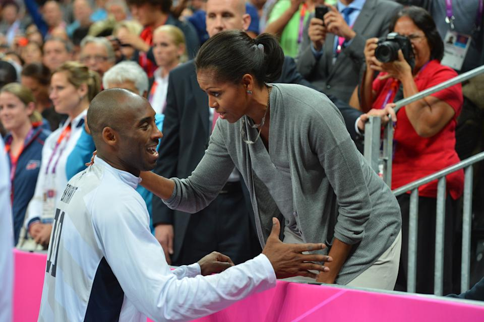 Kobe Bryant #10 of the USA Mens Senior National team talks to The First Lady Michelle Obama after defeating France 98-71 at the Olympic Park Basketball Arena during the London Olympic Games on July 29, 2012 in London, England. NOTE TO USER: User expressly acknowledges and agrees that, by downloading and/or using this Photograph, user is consenting to the terms and conditions of the Getty Images License Agreement. Mandatory Copyright Notice: Copyright 2012 NBAE (Photo by Jesse D. Garrabrant/NBAE via Getty Images)