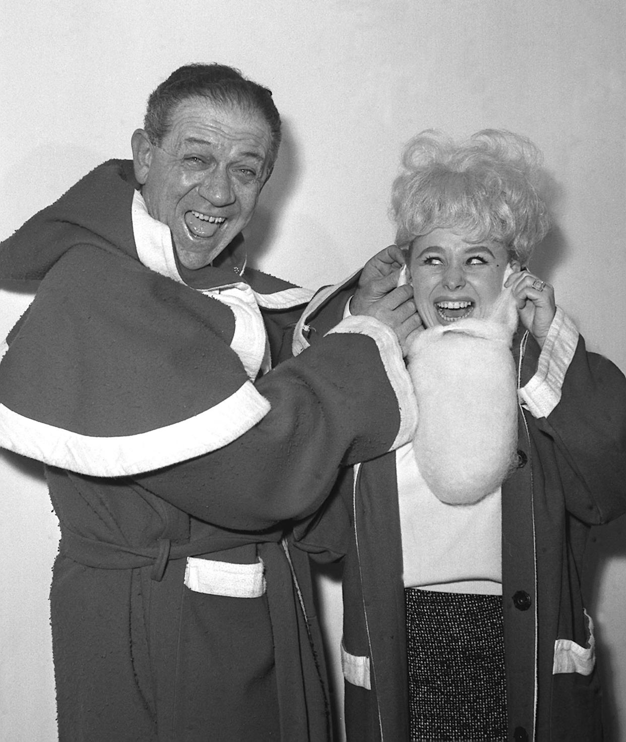 Sid James and Barbara Windsor dress up as Santa Claus for the Variety Club luncheon