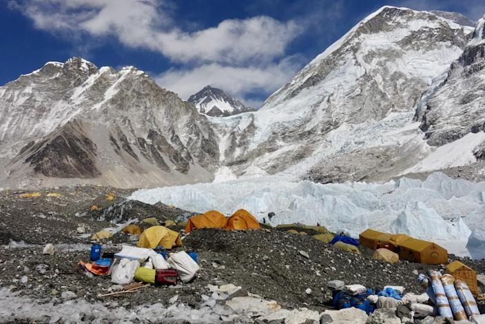 A collection of tents and mountaineering equipment in the icy Himalayas