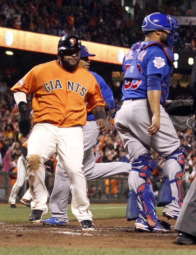 San Francisco Giants' Pablo Sandoval scores a run past Chicago Cubs catcher Welington Castillo on a double by Jeff Francoeur against Chicago Cubs during the seventh inning of a baseball game on Friday, July 26, 2013, in San Francisco. (AP Photo/Tony Avelar)