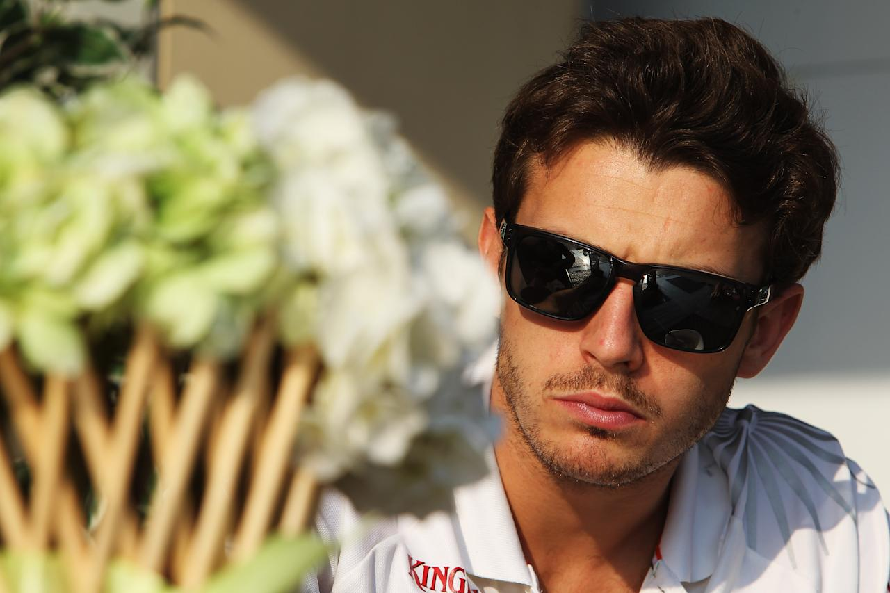 ABU DHABI, UNITED ARAB EMIRATES - NOVEMBER 01:  Jules Bianchi of France and Force India is seen in the paddock during previews for the Abu Dhabi Formula One Grand Prix at the Yas Marina Circuit on November 1, 2012 in Abu Dhabi, United Arab Emirates.  (Photo by Ker Robertson/Getty Images)