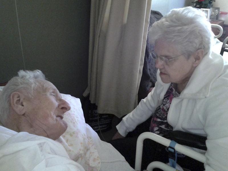 This June 2013 photo provided by the Knapke family shows Harold and Ruth Knapke. Relatives of the Ohio couple, who died at a nursing home 11 hours apart on the same day, said their love story's ending reflects their devotion over 65 years of marriage. The Knapke's died in their shared room on Aug. 11, days before their 66th anniversary. (AP Photo/Knapke Family)