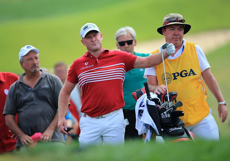 Jamie Donaldson of Wales prepares to hit an approach shot on the first hole during the final round of the 96th PGA Championship at Valhalla Golf Club on August 10, 2014 in Louisville, Kentucky